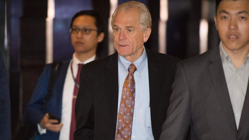 White House economic advisor Peter Navarro, center, walks through a hotel lobby as he heads to the Diaoyutai State Guest House to meet Chinese officials during trade talks in Beijing on May 4.