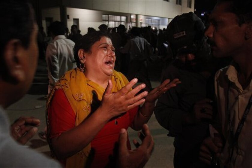 A Pakistani mother mourns foor her two sons who are missing after suicide attacks on the shrine in Karachi, Pakistan on Thursday, Oct. 7, 2010. Twin explosions rocked a famed Sufi shrine in the southern Pakistani city of Karachi on Thursday, killing many people and wounding scores, and sending a stark reminder of the threat posed by Islamist militants to this U.S.-allied nation.(AP Photo/Shakil Adil)