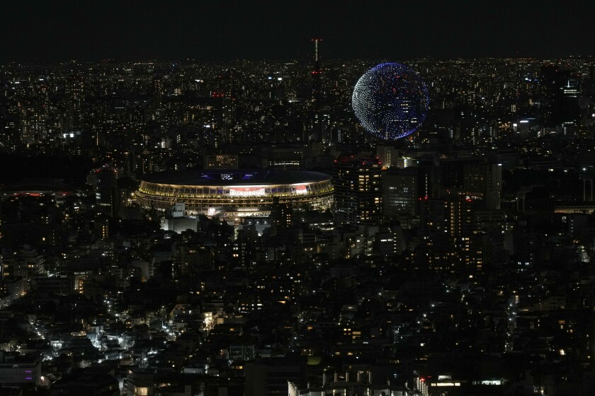 FILE - In this July 23, 2021, file photo, drones fly over the National Stadium during the opening ceremony of 2020 Tokyo Olympics is seen from Shibuya Sky observation deck in Tokyo, Japan. (AP Photo/Eugene Hoshiko, File)