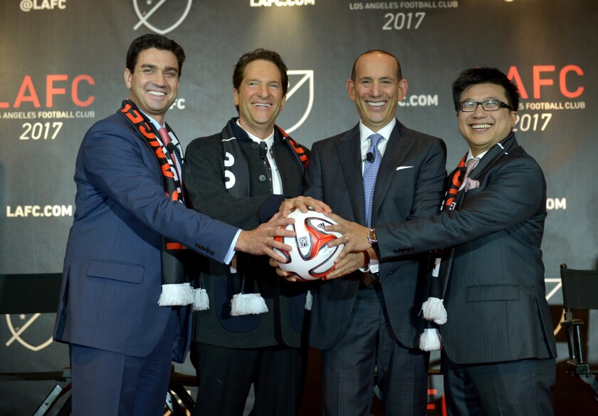 MLS Commissioner Don Garber, second from right, joins Los Angeles Football Club co-owners Tom Penn, left, Peter Guber and Henry Nguyen at a news conference in 2014.