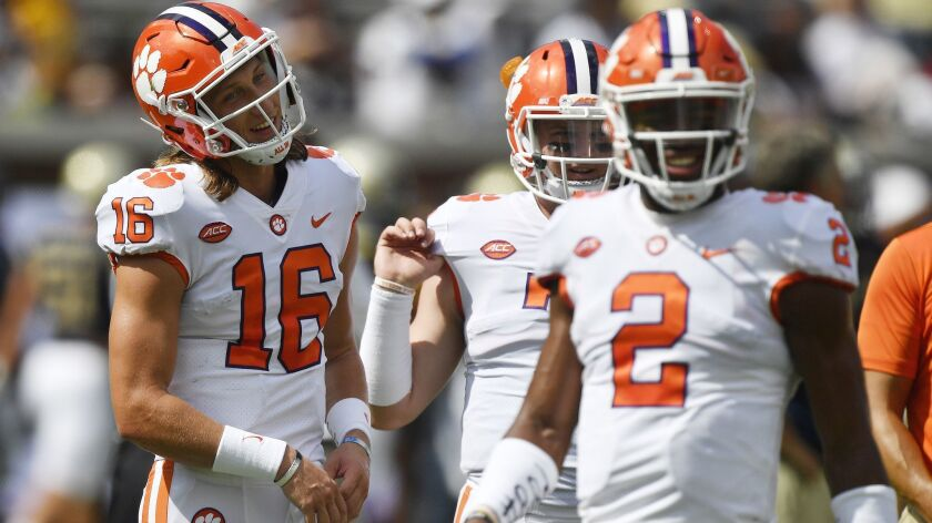 FILE - In this Saturday, Sept. 22, 2018, file photo, Clemson quarterbacks Trevor Lawrence (16) and K