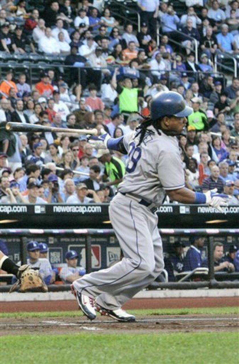Los Angeles Dodgers' Manny Ramirez follows through on an RBI single during the first inning of a baseball game against the New York Mets Thursday, July 9, 2009, in New York. (AP Photo/Frank Franklin II)