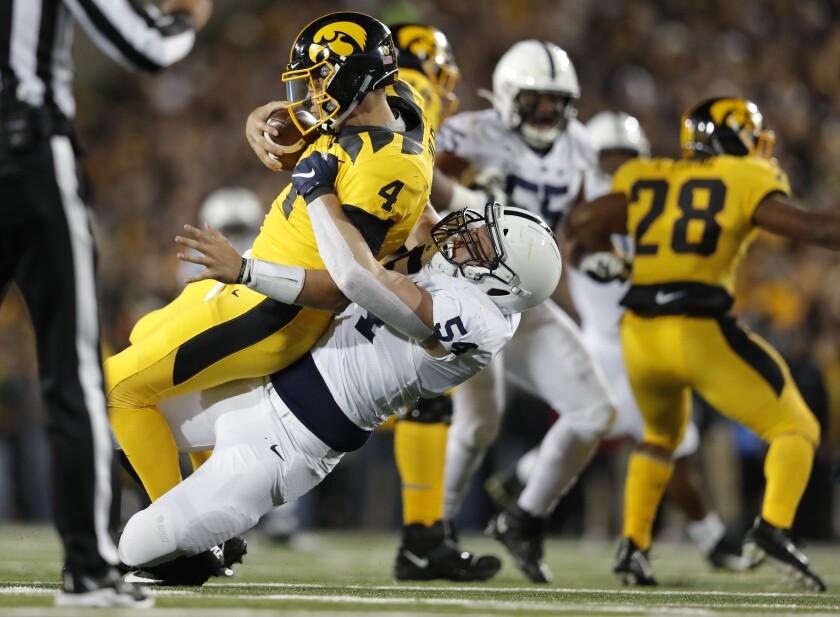 Penn State defensive tackle Robert Windsor, center, sacks Iowa quarterback Nate Stanley during the second half of an NCAA college football game Saturday, Oct. 12, 2019, in Iowa City, Iowa. (AP Photo/Matthew Putney)