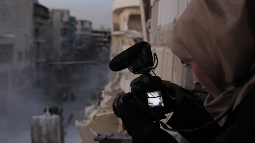 Waad al-Kateab films the ruins of a building destroyed by bombing in besieged east Aleppo, Syria.