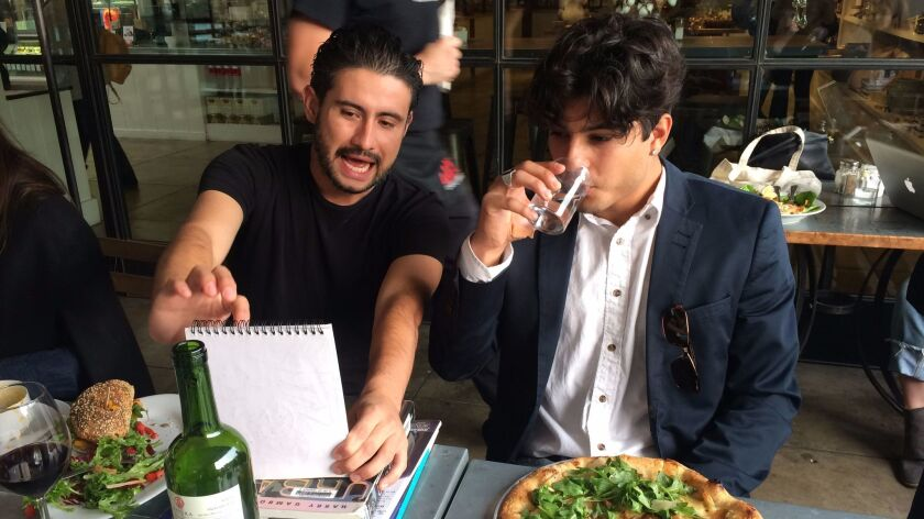 Emmanuel Macias and Isaac Ybarra chat at the post-shoot lunch. The fotonovelas are art, but they also are about creating community.