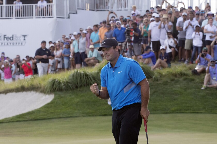Patrick Reed pumps his fist after clinching the win at the Northern Trust on Sunday.