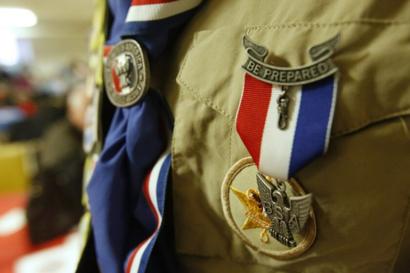 David Fite's Eagle award hangs on the left pocket of his Boy Scout shirt in Chicago on Sunday, Jan. 3, 2016. To earn Eagle rank, David earned 21 merit badges and organized a two-part community service project to support and help the city's gay community. (AP Photo/Martha Irvine)