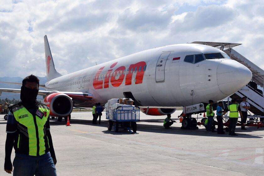 In this file photo taken on Oct. 10, 2018, a Lion Air Boeing 737 Max 800 aircraft is seen at the tarmac of the Mutiara Sis Al Jufri airport in Palu, Indonesia.