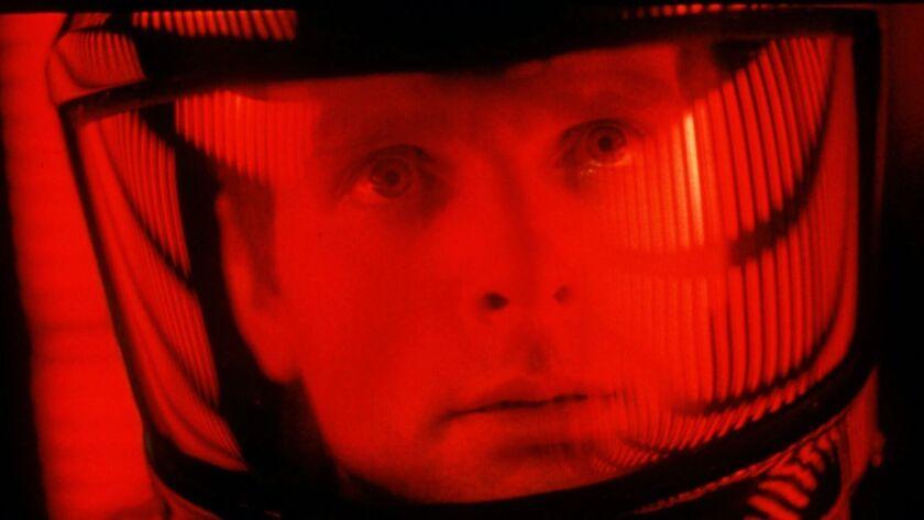 ADVANCE FOR WEEKEND EDITIONS DEC. 28-JAN. 1--Actor Keir Dullea peers through his space helmet in Sta