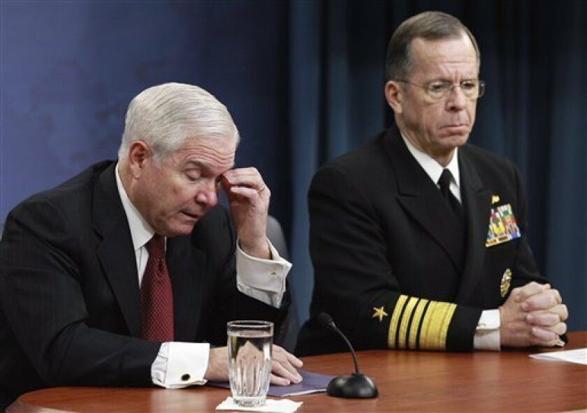 Defense Secretary Robert Gates, left, and Joint Chiefs Chairman Adm. Mike Mullen talk to the media about defense budget cuts, Thursday, Jan. 6, 2011, at the Pentagon. (AP Photo/Alex Brandon)