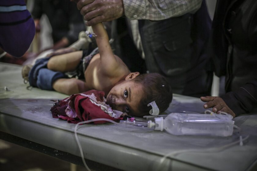 Syrians receive first aid in a field hospital following an airstrike by forces loyal to the Syrian government in the rebel-held area of Douma, located in the outskirts of Damascus, on Nov. 10.
