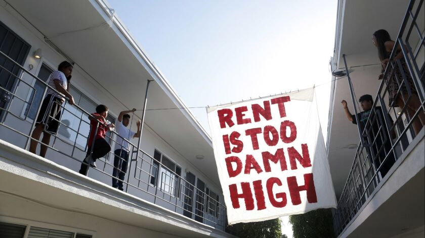 Organizers with Housing Long Beach, a local advocacy group pushing for rent control and eviction protections, protesting with tenants.