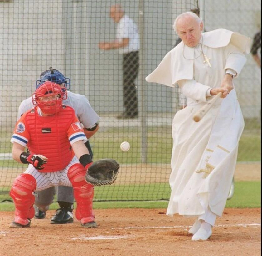 Playing Pope John Paul II, retired real estate broker Gene Greytak takes a swing during a N.Y. Mets fantasy camp in 1996.