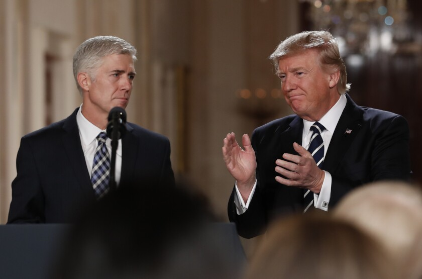 President Donald Trump applauds as he stands with Judge Neil Gorsuch in East Room of the White House in Washington on Jan. 31, 2017.