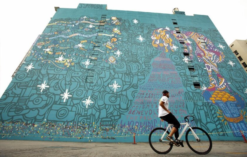 A huge mural on the wall of the Santa Fe Building at 539 S. Los Angeles St. in downtown L.A. has been saved, at least for now.
