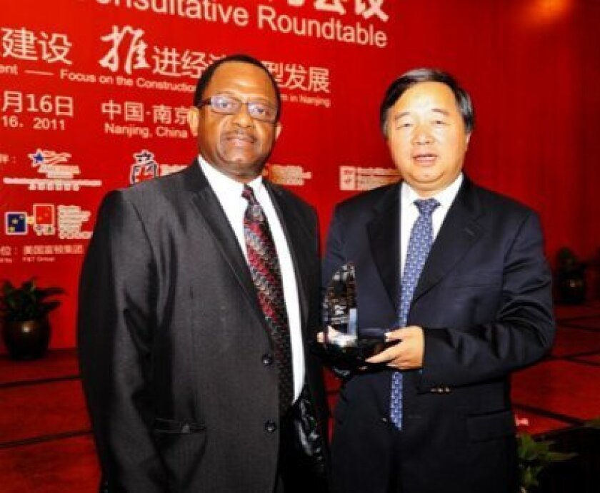 Wayne Darbeau, left, meets with Nanjing Mayor Ji Jianye