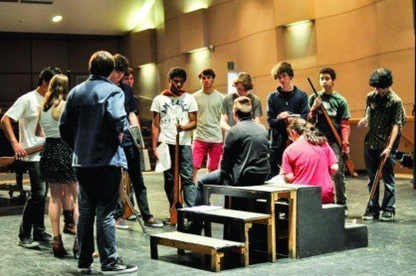 Les Misérables cast members rehearse the barricade scene. Photo/Daria Sheik, CCA student