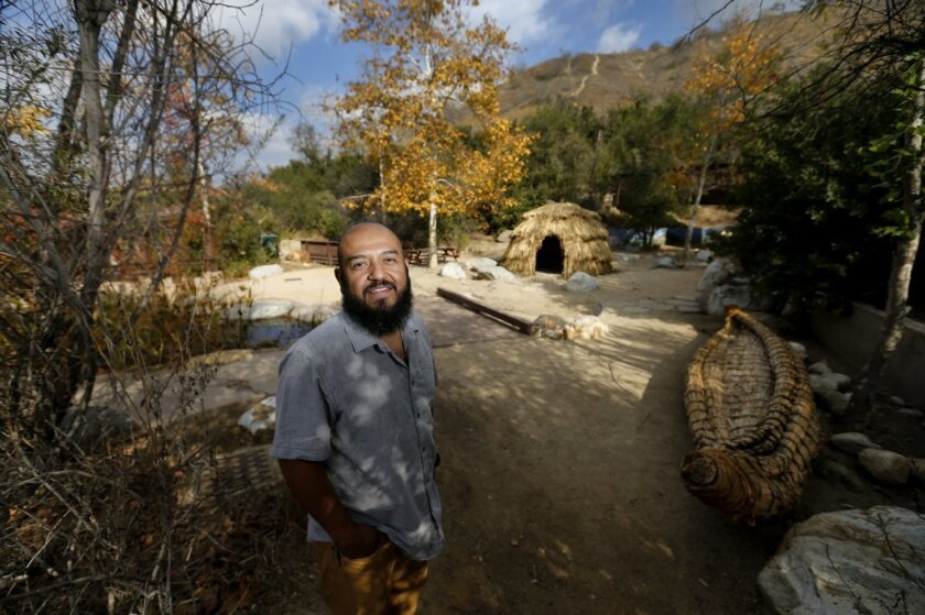 Marcos Trinidad, director of the Audubon Center at Debs Nature Center, looks over the property.