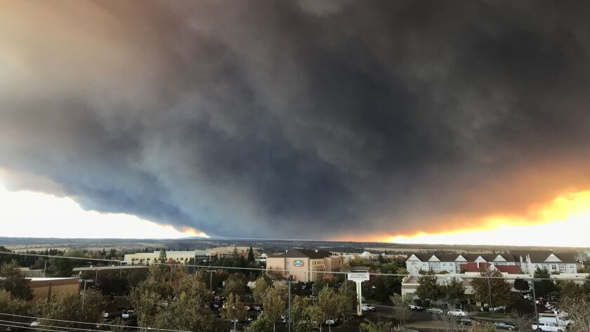 The massive plume from the Camp fire as seen from Chico, Calif. A new federal government report warns to expect more of these types of catastrophes.