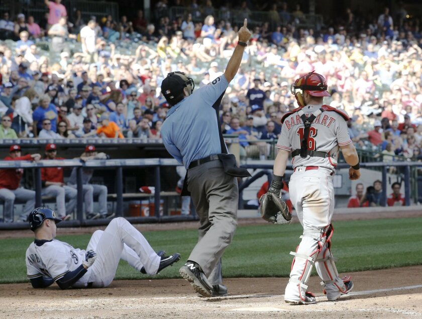 Home plate umpire James Hoye ejects Cincinnati Reds starting pitcher Alfredo Simon after hitting Milwaukee Brewers' Chase Anderson with a pitch during the fifth inning of a baseball game Saturday, May 28, 2016, in Milwaukee. (AP Photo/Morry Gash)