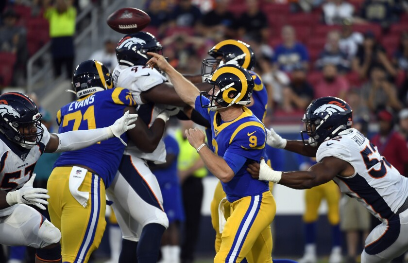 Rams quarterback John Wolford throws a pass during the team's 10-6 preseason victory over the Denver Broncos on Saturday.
