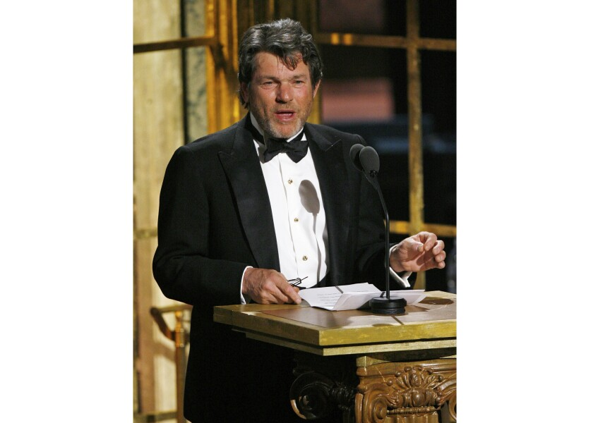 """FILE - In this March 10, 2008 file photo Jann Wenner, co-founder of the Rock and Roll Hall of Fame Foundation and publisher of """"Rolling Stone"""", speaks at the Rock and Roll Hall of Fame Induction Ceremony in New York. Wenner will retire next year as chairman of the Rock and Roll Hall of Fame Foundation in New York. Wenner announced Wednesday, Sept. 25, 2019, that he will step down on Jan. 1, 2020. (AP Photo/Jason DeCrow, File)"""