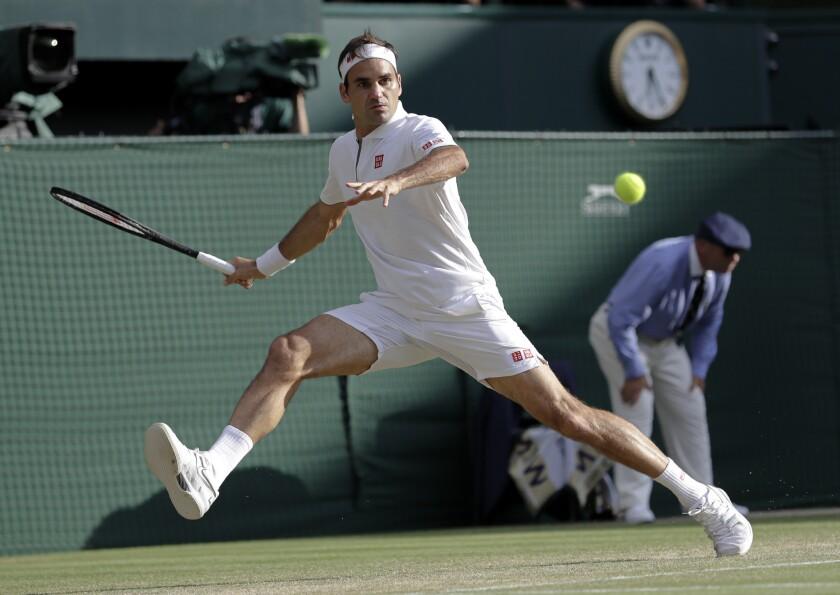 Switzerland's Roger Federer returns the ball to Spain's Rafael Nadal during a men's singles semifina