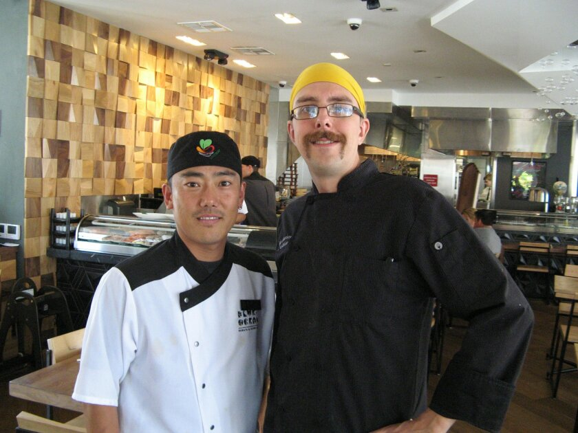 Blue Ocean Robata & Sushi's lead chef Andrew Halvorsen, right, with lead sushi chef Brandon Chang inside the new Carlsbad restaurant.
