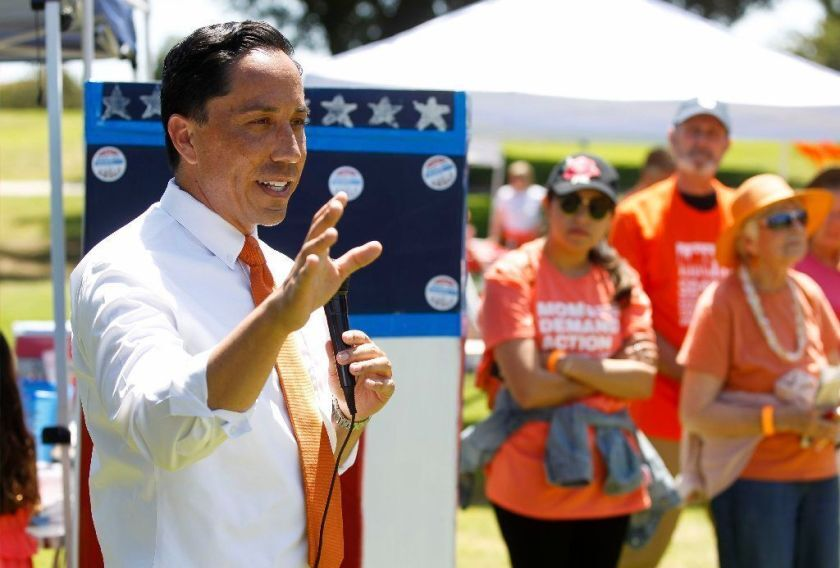 A bill that would end gun shows at the Del Mar Fairgrounds has advanced to the governor's desk after months of advocacy from Assemblyman Todd Gloria, pictured here speaking at a picnic and community fair hosted by the Wear Orange coalition last year.