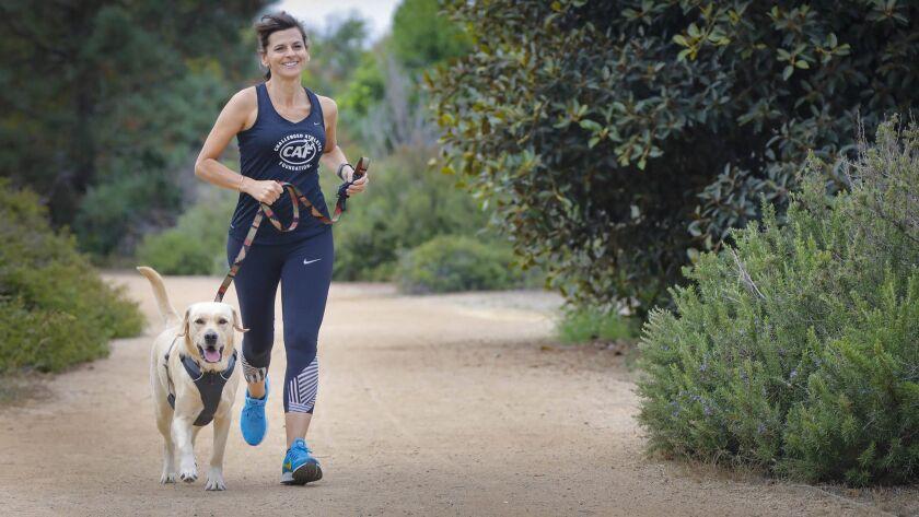 SAN DIEGO, CA 9/5/2018: Kristine Entwistle runs with her dog, Archer, a two-year-old labrador retrie
