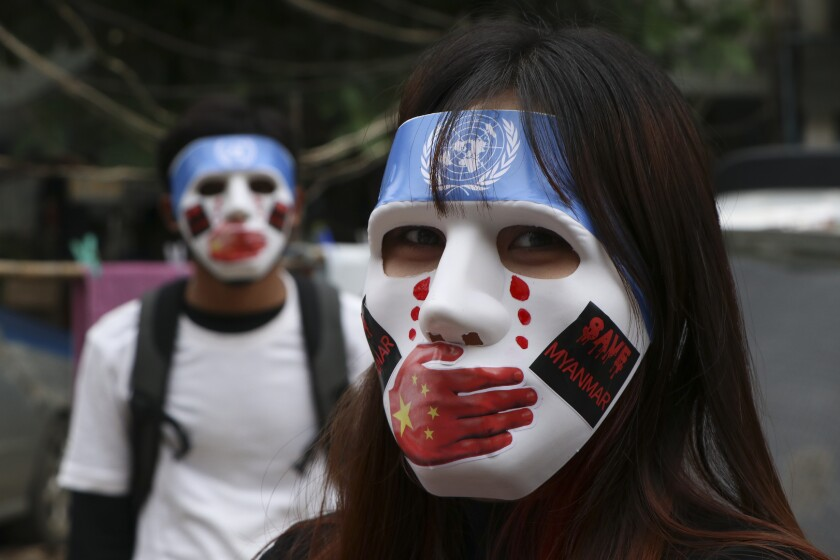 FILE - In this April 4, 2021, file photo, young demonstrators participate in an anti-coup mask strike in Yangon, Myanmar. Many in Myanmar have found a safer, more substantive way to protest the country's military coup. Instead of facing down heavily armed solders from behind flimsy barricades, they're holding online rummage sales using sites like Facebook. (AP Photo, File)