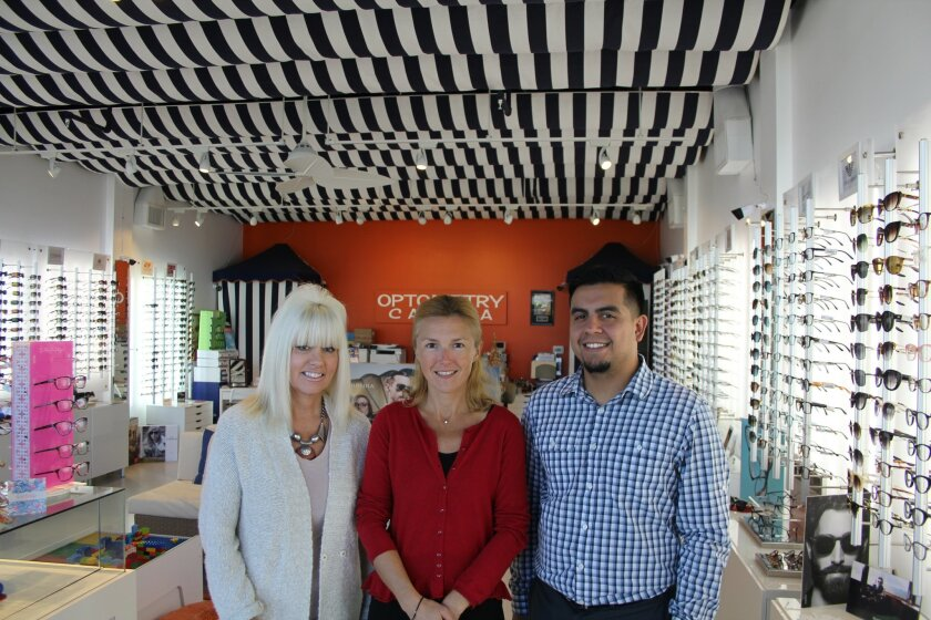 Dr. Tania Stevens, center, with Optometry Cabana employees Joanne and Gabriel. Photo by Karen Billing