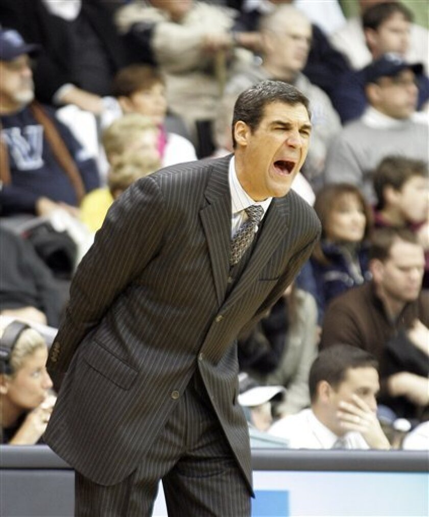 Villanova head coach Jay Wright shouts directions to his players during the first half of a NCAA college basketball game with Cincinnati Sunday, Jan. 9, 2011, in Villanova, Pa. (AP Photo/Tom Mihalek)