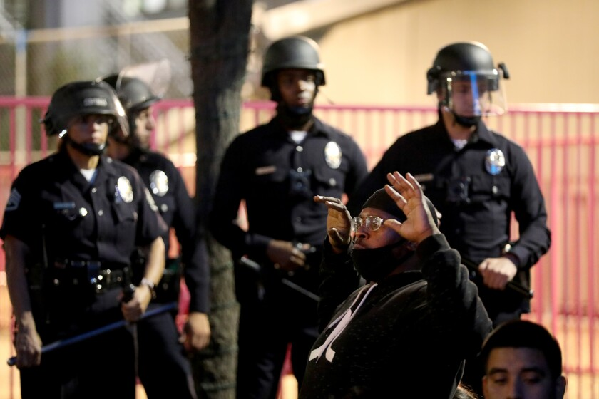 Protesters are arrested by police in front of City Hall in downtown L.A.
