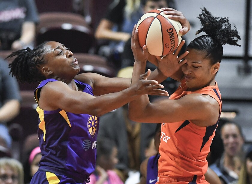 Sparks forward Nneka Ogwumike, left, and Connecticut forward Alyssa Thomas fight for a rebound.