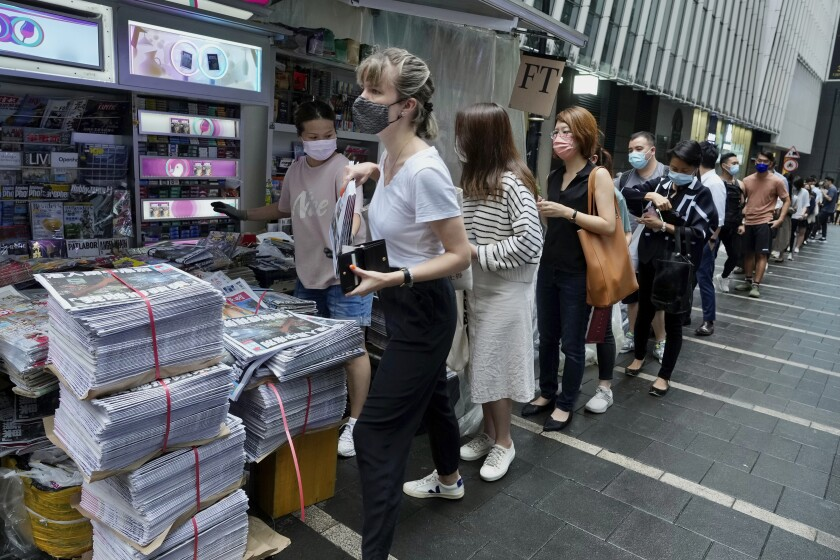 People queuing to buy newspaper
