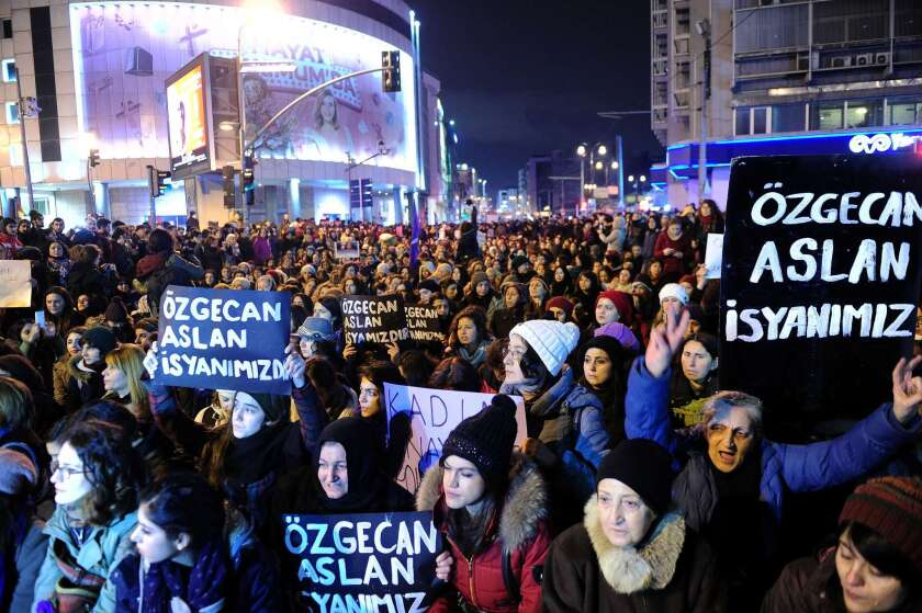 """Women shout slogans and hold placards reading """"Ozgecan Aslan is our rebellion"""" during a demonstration in Istanbul on Saturday following the young woman's slaying."""