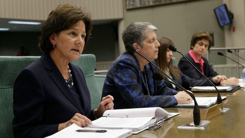 Monica Lozano, left, then-chairwoman of the University of California Board of Regents, discusses an audit of the office of UC President Janet Napolitano, second from left, at a legislative hearing. State Auditor Elaine Howle, right, said UC improperly interfered in her work.