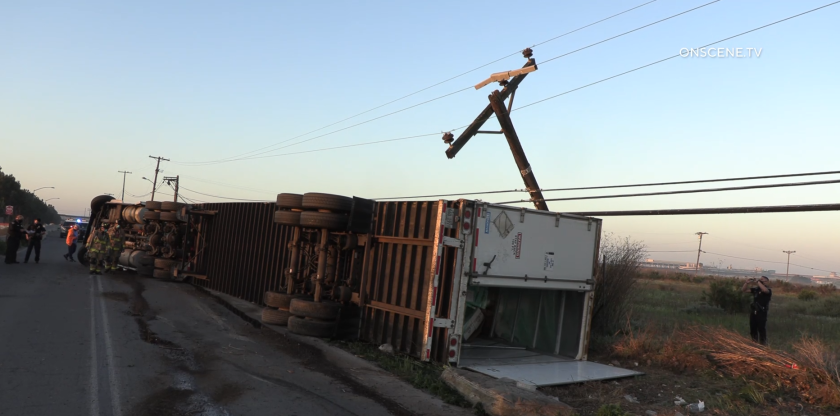A semi-truck overturned and hit a power pole early Wednesday in Otay Mesa.