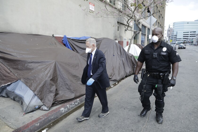 Judge David O. Carter tours skid row with a police officer.