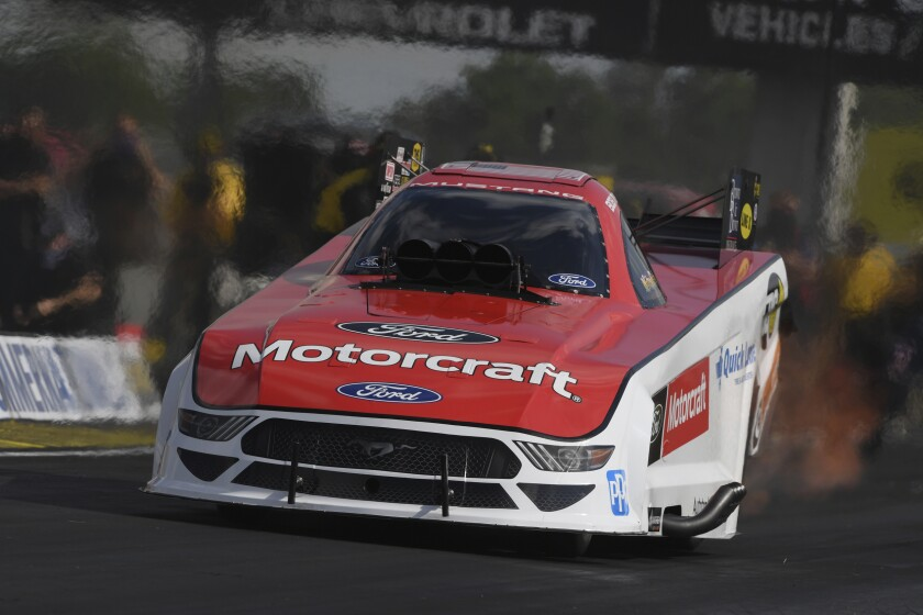 In this photo provided by the NHRA, Bob Tasca III is back in the seat of his Funny Car and powers his way to the top of field after a battle of COVID-19, Saturday, July 18, 2020, at Lucas Oil Raceway in Indianapolis. (Jerry Foss/NHRA via AP)