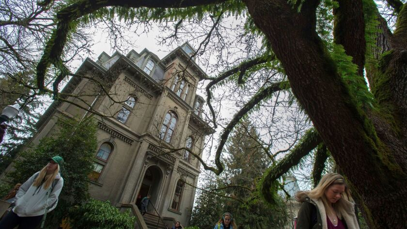 Students exit Deady Hall on the campus of the University of Oregon Wednesday on Jan. 25.