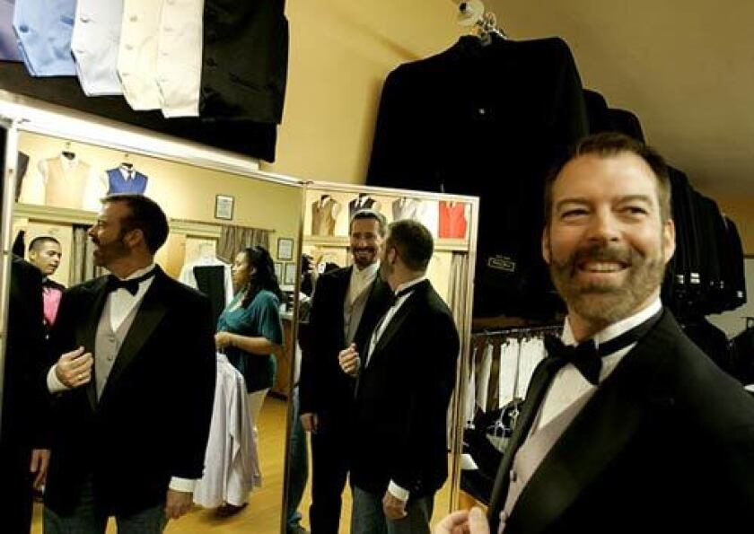 Paul Waters, right, and his partner Kevin Voecks check the fit of their tuxedos for their wedding Tuesday, June 17, 2008. Assemblyman Mike Feuer (D- Los Angeles) will officiate the ceremony in a Studio City corporate office garden.