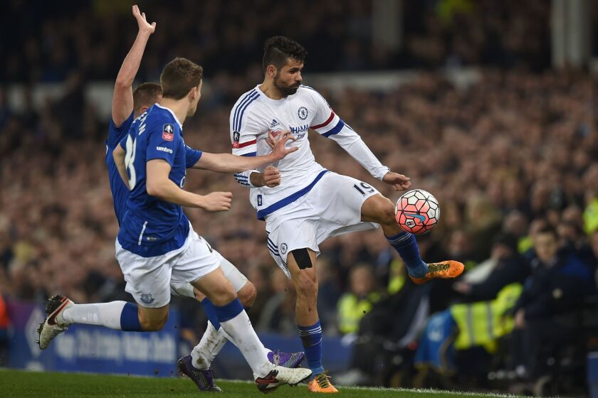 Chelsea's Diego Costa vies with Everton's James McCarthy, left, and Seamus Coleman on March 12.