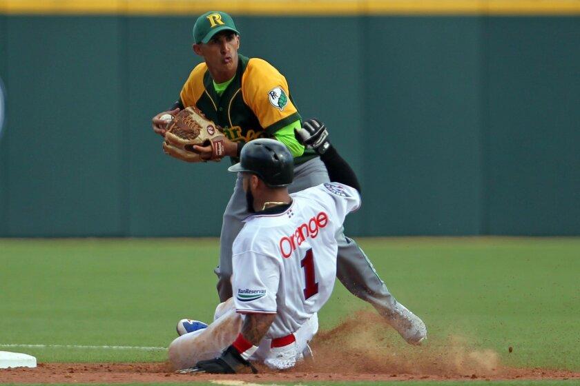 Cuba shortstop Yadiel Hernandez forces out Dominican Republic's Leury Garcia at second base during a Caribbean Series baseball game in San Juan, Puerto Rico, Tuesday, Feb. 3, 2015. (AP Photo/Ricardo Arduengo)