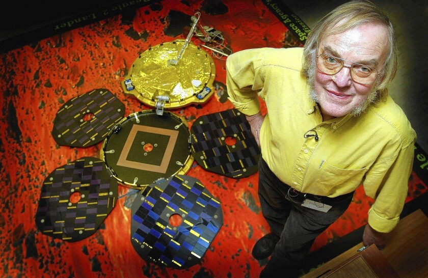 Scientist Colin Pillinger poses with a model of Beagle 2 in 2003.