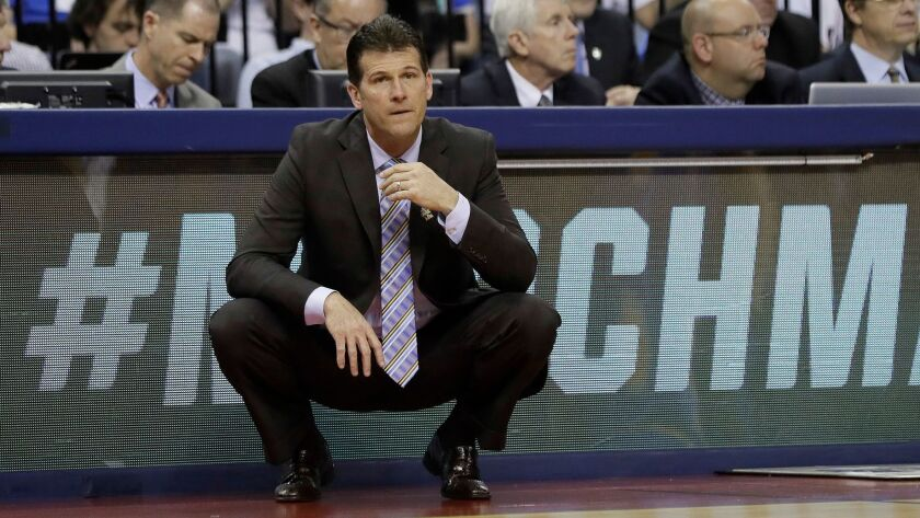UCLA head coach Steve Alford watches play against Kentucky in the second half of an NCAA college bas