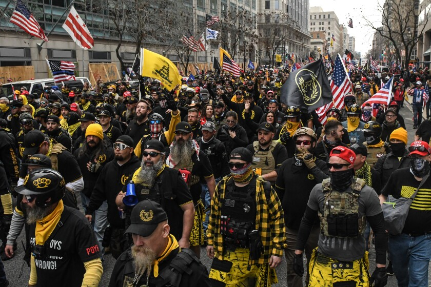 Members of the Proud Boys march during a protest on in Washington, DC.