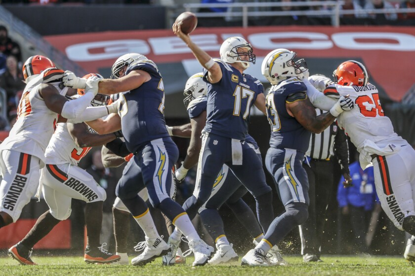 Chargers quarterback Philip Rivers delivers a pass from a clean pocket during a route of the Cleveland Browns at Firstenergy Stadium on Sunday.
