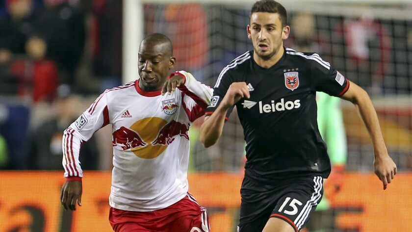 D.C. United defender Steve Birnbaum, right, is pressured by Red Bulls forward Bradley Wright-Phillips while bringing the ball up the pitch during a Major League Soccer game Nov. 2.